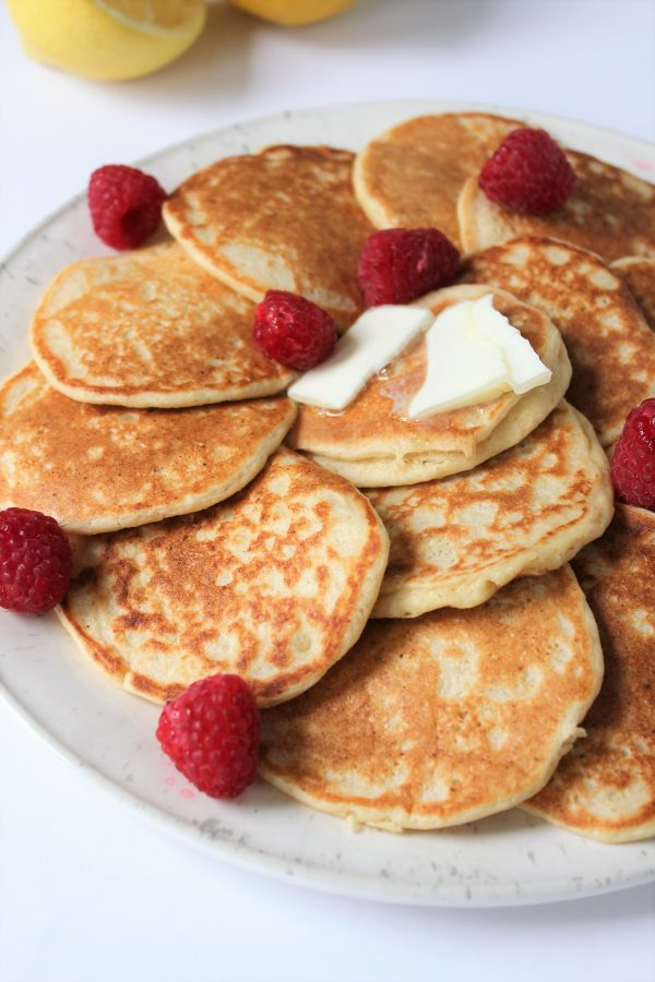 healthy gluten free lemon ricotta pancakes made with oat flour and sweetened with a touch of honey!