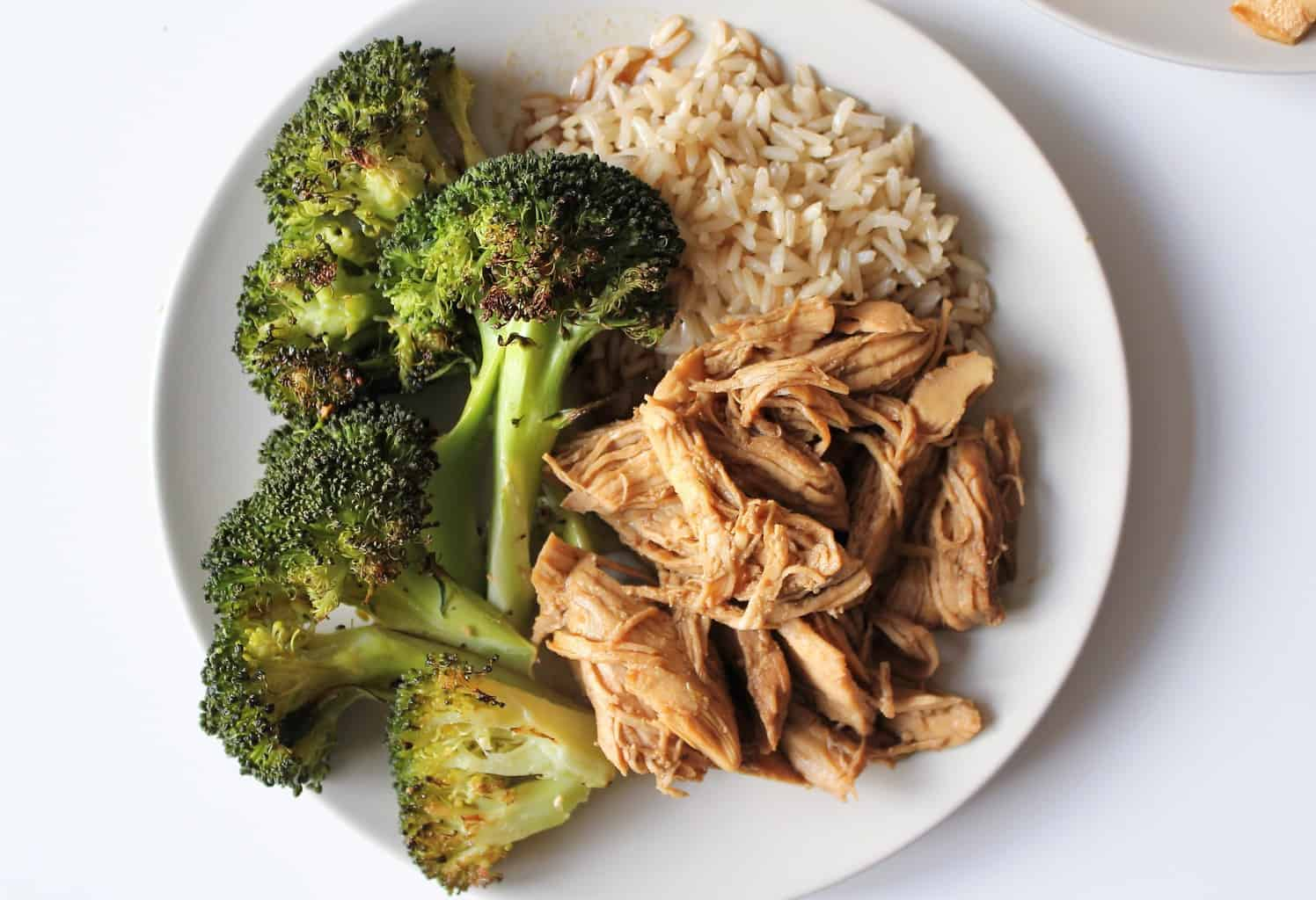 Close up bite on Instant Pot Teriyaki Chicken made with chicken breast | The Granola Diaries
