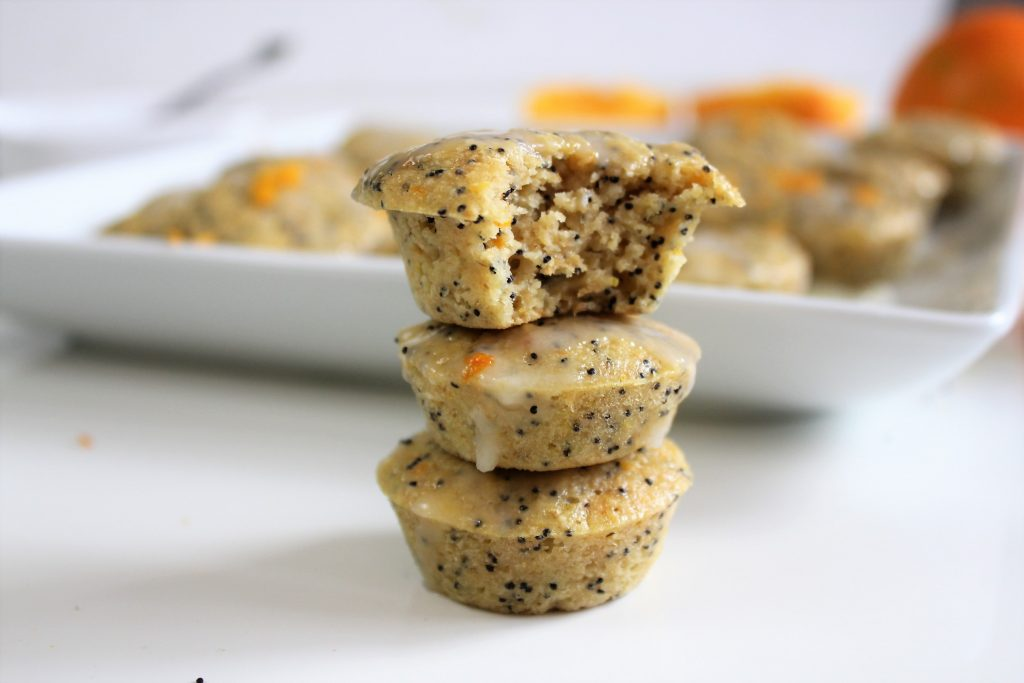 Stack of gluten free orange poppyseed muffins