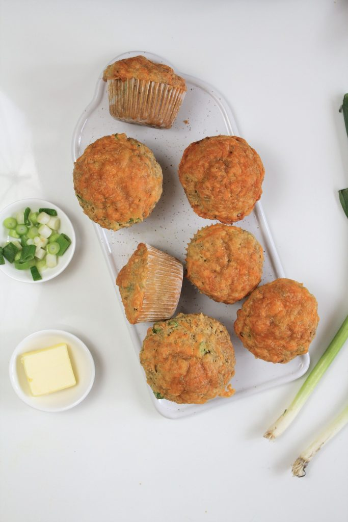 Savory Cheddar Muffins with scallions and butter. A delicious savory breakfast!