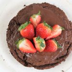gluten free flourless chocolate cake with strawberries on top