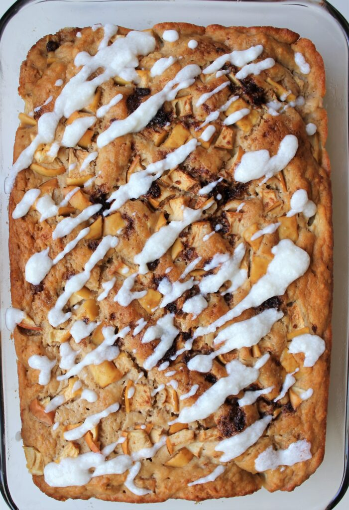 This Apple Yogurt Cake Recipe is delicious, moist, and super easy. It is refined sugar free, nut free, and can easily be made gluten free with a gluten free flour option. It comes together in only a few minutes and makes a delicious, healthy snack! #applecake #yogurtcake #appleyogurtcake #snackingcake #applecinnamoncake
