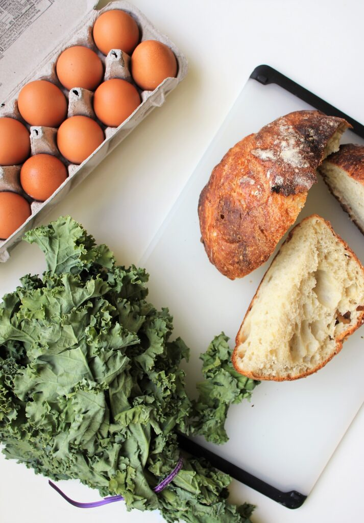Mise En place of leftover homemade bread, kale, and eggs