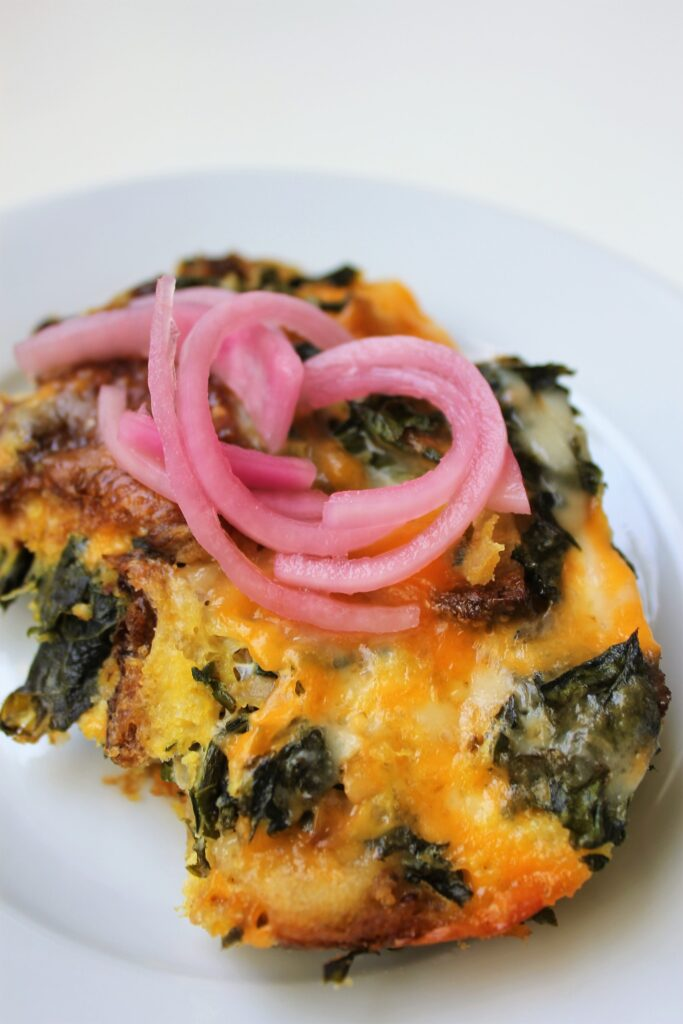 strata with pickled onions on top