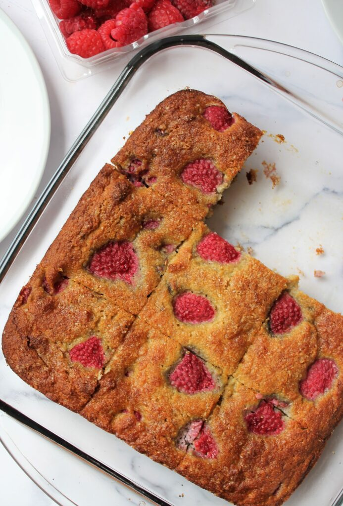 overhead shot of healthy raspberry summer cake in a pan