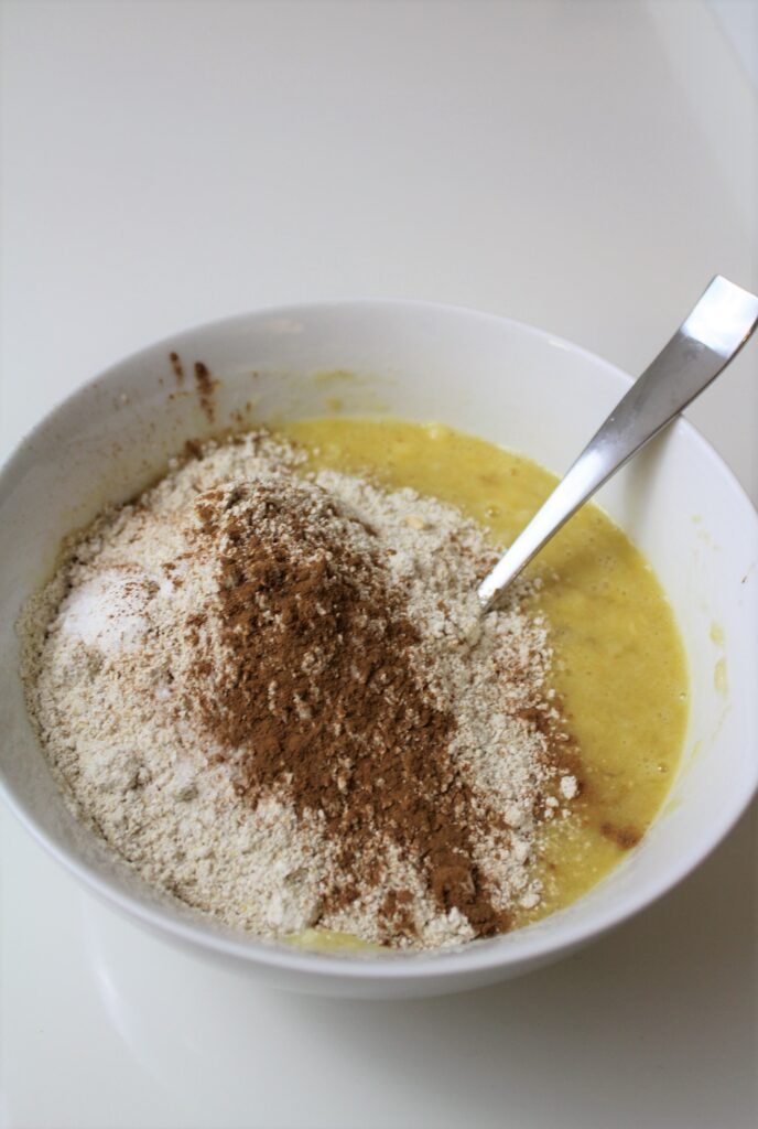 dry ingredients being added to wet ingredients