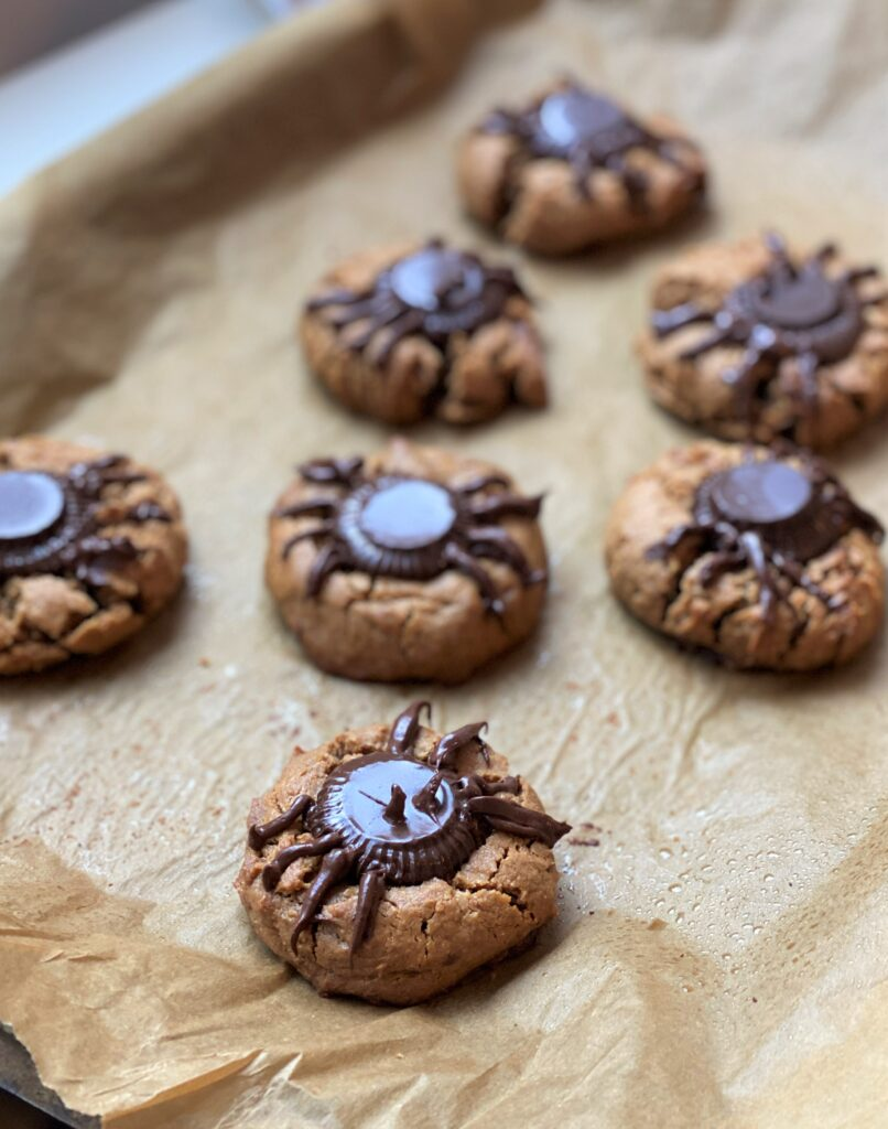 just made peanut butter spider cookies, chocolate is melting on top of the cookies
